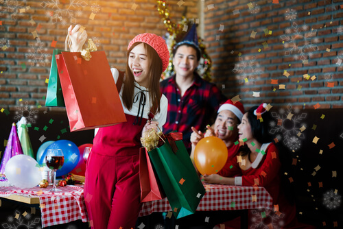 students opening Christmas gifts