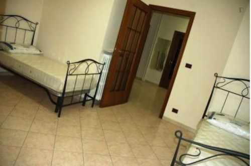 Bed in a nice twin bedroom in a 2-bedroom apartment in Lingotto