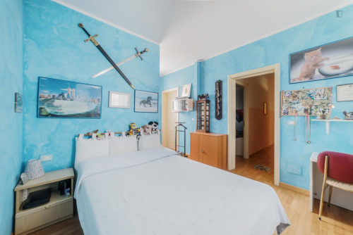 Colourful bedroom in 3-bedroom apartment
