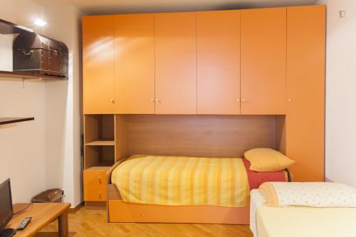 Bed in a twin ensuite bedroom, in a 3-bedroom flat near Giardino Farpi Vignoli