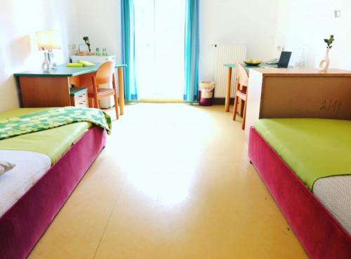 Bed in a twin bedroom, in a residence in Penzing