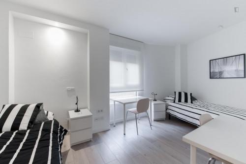 Twin bedroom, with an ensuite bathroom, in Berruguete  - Gallery -  1